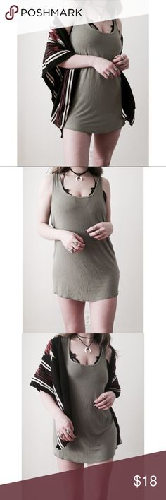 Olive Green Racerback Sleeveless T-Shirt Dress 🌻🌻👁🌻🌻  I try to exhibit each item in my closet as accurately as possible (color, sizing, etc.) I am more than happy to provide measurements and additional item information as needed.  Mossimo Supply Co. By Target.  Your order ships same or next business day.  Questions or inquiries? Feel free to gimme a shout!  Price is always negotiable; however, please offer respectfully. Thank you! ✌🏻️ Urban Outfitters Dresses Mini