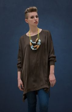 A loose fitting item, the Crew Neck Tunic creates a relaxed silhouette. The graduated hem and close fitting round neckline allow the top to drape softly onto the body. The cuffed sleeves exaggerate the flowy look and a dropped shoulder adds to this easy style. A great tunic for layering depending on the weather!