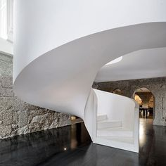 A sweeping renovation of an 18th-century Portuguese farmhouse by ES1Arq included adding a sleek white staircase in reinforced concrete with Namibian marble steps. Photography by FG+SG Architectural Photography/Photofoyer. #architecture #design #interiordesign #interiors #staircase... - Interior Design Ideas, Interior Decor and Designs, Home Design Inspiration, Room Design Ideas, Interior Decorating, Furniture And Accessories