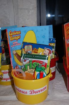 "curious george - The Boy Party Favors- yellow bucket with their Name ""Curious___"" filled with a coloring book, grab and go party pack, book mark, beach ball, cup, bubbles, lollipop and apple crisps."