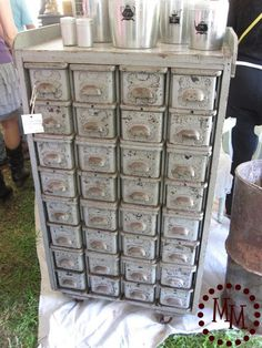 Sewing Machine Drawers - a collection of salvaged drawers fit perfectly in an old cabinet.