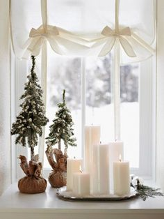 in Snow-White Style - Group candles in a window for a warm holiday decoration. For more shots of this house: www.midwestl -Decorate in Snow-White Style - Group candles in a window for a warm holiday decoration. For more shots of this house: www. Noel Christmas, Little Christmas, Christmas And New Year, Winter Christmas, All Things Christmas, Christmas Candles, Christmas Vignette, Modern Christmas, Rustic Christmas