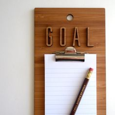 Could do this, get wood letters glue onto clipboard and write whatever word you want: To-do, Goals, Wish, Bills, Grocery etc...