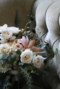 heavy on the textures, muted pinks, ivories again with tiny touch of dark - with interesting greenery / textures