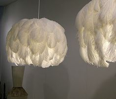 Awesome DIY feather pendant light. This would look awesome in a nursery!