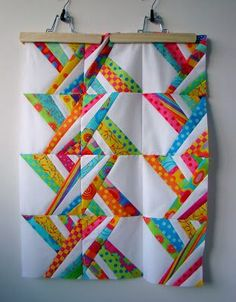 Bright and colorful quilt- super cute! It appears to be very simple in construction!