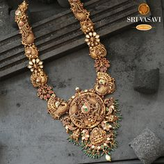 A deeply-embossed 22kt Antique gold long necklace in antique-finish, featuring traditional motifs; the Lakshmi pendant is held by a chain of annams. Antic Jewellery, Gold Temple Jewellery, Antique Jewellery Designs, Gold Wedding Jewelry, Gold Earrings Designs, Royal Jewelry, Antique Jewelry, Gold Jewelry, Indian Bridal Jewelry Sets