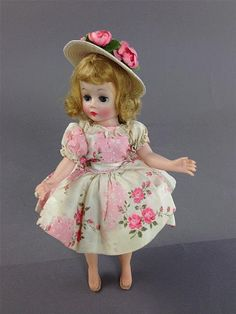 MADAME ALEXANDER CISSETTE IN PINK FLORAL PRINT LIKELY FAO SCHWARZ SPECIAL, HAIR IN ORIGINAL SET, FACIAL COLOR GREY, TAGGED DRESS IN...
