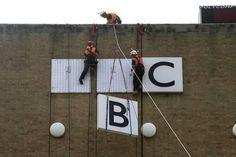 The signage being removed from BBC Television Centre, 2014