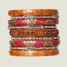 Orange and pink bangles. Chamak by Priya Collections.