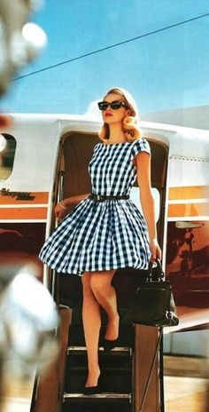 The airplane is such a nice accessory to this outfit!