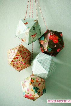 Paper ornaments made with patterned paper by Silvia Dekker from the Flow book for Paperlovers.silvia Paper ornaments made with patterned paper by Silvia Dekker from the Flow book for Paperlovers. Origami Ball, Diy Origami, Origami Paper Art, Diy Paper, Dollar Origami, Origami Ornaments, Paper Ornaments, Christmas Ornaments To Make, How To Make Ornaments