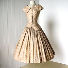 Stylish 1950's Tan-and-White Cocktail Dress by Suzy Perette New York. Classic silhouette with fitted bodice, cinched waist, and a full, swingy skirt. Fabulous shoulder skimming shawl collar.    polished cotton nude and white polkadot full skirt dress