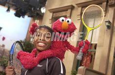 Venus Williams and Elmo during...