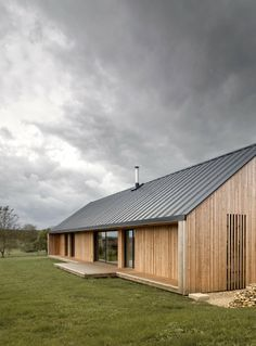 The Maison Simon, designed by Mathieu Noël & Élodie Bonnefous, is a private home in Vezet, France. Built in the village where the client began his career, the barn-like house showcases the owner's personal history through its architecture as. Rural House, House In The Woods, Metal Building Homes, Building A House, Building Ideas, Metal Homes, Residential Architecture, Modern Architecture, Farmhouse Architecture