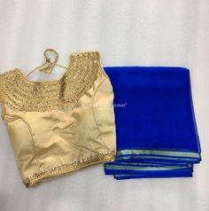 Royal Blue Georgette Saree from a small boutique store in Gujarat, with a slim Zari line at the edge and a stunning designer sleeveless choli-blouse in Golden Silk synthetic blend fabric with stone-work embellishments around the neckline and further detail and piping at the edges of armpits and waist. The blouse is well-structured for a great fit and has ties at the back. #craftsofindia #indianhandicrafts #madeinindia #craftsbazaar #artsandcrafts #handmade
