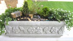 Love the use of a window planter box to give a different shape to a mini garden! via Two Green Thumbs