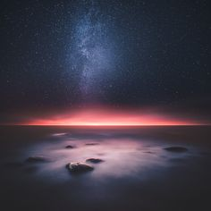 A gorgeous shot of a pink horizon and some stars.