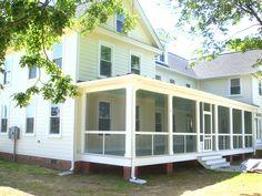 Beautiful farmhouse style home with an expansive front porch #porch #farmhouse ©Balducci Builders, Inc.