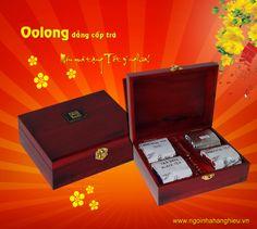 Hộp trà biếu tết sang trọng - Trà Olong 4 vị hộp gỗ đỏ 400g Trà ngon biếu tết là phong tục không thể thiếu của người Việt Nam. www.ngoinhahanghieu.vn cung cấp sản phẩm trà cao cấp Oolong được đựng trong hộp gỗ sang trọng tạo cho món quà thêm trang trọng.