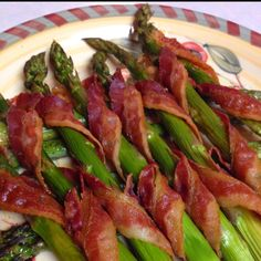 Disneyland inspired- love these at the Bengal BBQ in adventure land. Bacon Wrapped Asparagus. Clean asparagus, cut ends off, wrap with bacon and bake at 350 until bacon is crispy. Or grill on skewers.