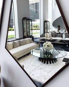 Modern home inception by Christopher Guy. Trapezoid mirror looking into a chic and modern all black and white home. Paint Color Palettes, Black And White Interior, White Houses, Contemporary, Modern, Living Room Designs, Sweet Home, Dining Table, Interior Design