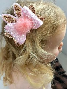 "Eater bunny ears bow. This bow is approx 3.5"" in size made from a textured pink flecked fabric with rose gold glitter. This bow comes customised on headband or clip Item details. Headband we use are soft nylon headband one size fits all. Clips are stainless steel crocodile"