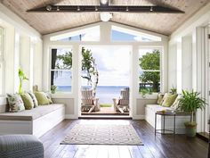 Before the remodel, this space off the living room, which leads to the back deck, didn't show off the pretty view of the Choctawhatchee Bay. So the Brookses installed French doors with trapezoid-shaped windows above them. Problem solved. Outdoor party supplies are stowed inside the storage benches that are covered with linen cushions and throw pillows.