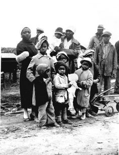 "These children were evicted legally--though at gunpoint--from their homes on the Dibble plantation near Parkin Arkansas, in January 1936. Plantation owners charged, and the court agreed, that because the parents belonged to the Southern Tenant Farmers Union, they were engaged in ""a conspiracy to retain their homes."" These families lived by the side of the road until they were moved to a tent colony. Photo by John Vachon."