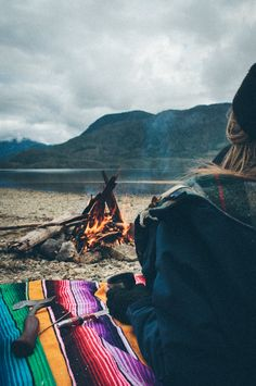 Mexican blanket, campfire, view.... I bet there is a Stout Tent Bell Tent behind her. #stouttent #belltent