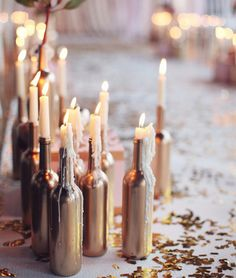 wine bottle centerpieces for wedding.like the idea of candles in them (Bottle Centerpieces) Winter Engagement Party, Engagement Ideas, Backyard Engagement Parties, Engagement Ring, Gold Bottles, Empty Bottles, Glass Bottles, Beer Bottles, Recycle Bottles