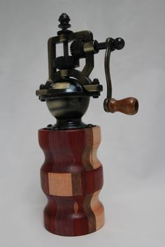 "This peppermill has an antique-style peppermill mechanism that adjusts easily from coarse to extra fine. The metal is an Antique Brass finish. It does not accommodate salt since it is metal. The body of the mill i contains 42 pieces of exotic woods. It is approx. 2.5""dia. x 8""H. Cards for the Care of Wood and the names of all the woods and origin are sent with the purchase. #618"