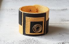 Handmade leather cuff bracelet. Black and gold geometric bracelet. Leather jewellery.