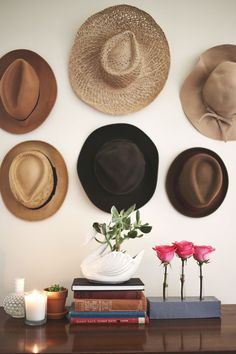 I love the idea of different hats being displayed this way!