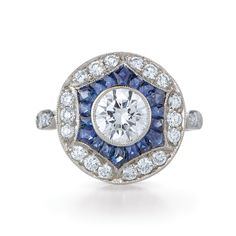 Kwiat, Round Diamond Ring in Platinum in a Vintage Style with a Sapphire and Diamond frame.