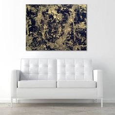Chaos in this gold on black artwork... amid the simplicity of a white room