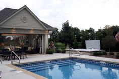 Custom built pool house with retractable roller screens.