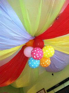 Great ceiling idea made with inexpensive colored tableclothes