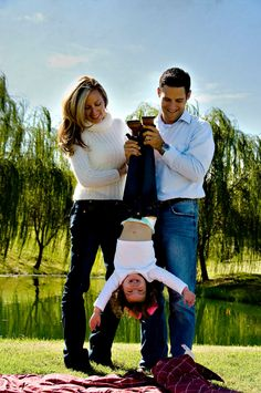 My favorite family portrait yet. Need to recreate this when the new baby is old enough to hang upside down for the sake of family photos.