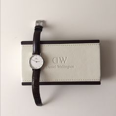 Daniel Wellington Watch Authentic. Excellent used condition. Dark brown leather strap in silver. Crystal index. Comes with original purchase box and tag. 26mm. No trades, price is firm, thank you! Daniel Wellington Jewelry