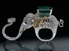 Ring   Designed by Narayan Jewelers (India) for The World Land Trust. It is part of a collection 'Emeralds for Elephants' which aimed to create awareness and raise crucial funds for the conservation initiative of Wildlife Trust of India for the Asian Elephant in India. Gold, diamonds and a Zambian emerald.