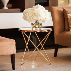 Imbue modern elegance into your living room with this fashionable Danya B Tetra Clear Glasstop Round End Table with Rose Gold Metal Frame. The sleek and slender rose gold-finished frame radiate opulen