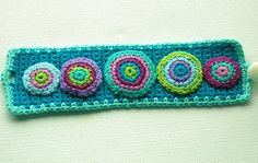 Crochet Cuff in Purple and Turquoise by AnnieDesign, via Flickr