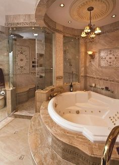 great warm colors, and amazing tile work! I love how big the tub is too