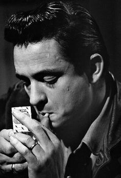 Johnny Cash photographed by Don Hunstein, 1960.