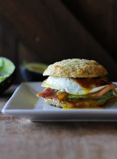 Bacon, egg, and avocado breakfast biscuits with mole sauce