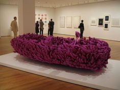 """Yayoi Kusama, Violet Obsession, 1994. Sewn & stuffed fabric over a rowboat and oars, 43 1/4"""" x 12' 6 3/8"""" x 70 7/8"""", collection MoMA, in Mind and Matter"""