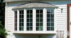 A 5-lite bow window with shingled hip roof adds character to any home. #windows #homeimprovement