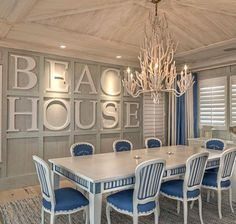 Bold Wall Designs in a Florida Beach House. Interesting finish treatment on the table and chairs, too.