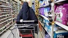 As a soldier stood in line at a California grocery store, a Muslim woman wearing a burka confronted the store's cashier about their American flag lapel pin, and everyone in the store heard it. But a man standing behind the soldier wasn't having any of it, and by the time he finished, the entire store was cheering.